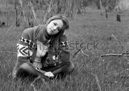 Young fashion girl with headphones sitting at grass. Photo in bl Stock photo © Massonforstock