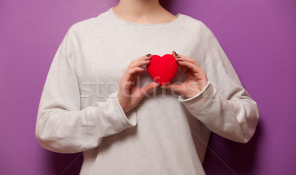 Woman holding heart shape toy Stock photo © Massonforstock