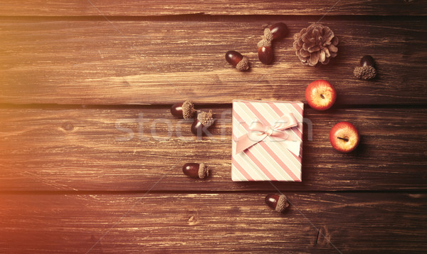 Gift box and pine cones with apples  Stock photo © Massonforstock