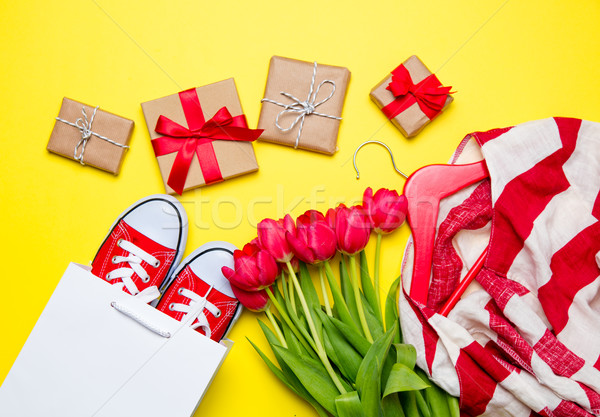 bunch of red tulips, red gumshoes, cool shopping bag, striped ja Stock photo © Massonforstock