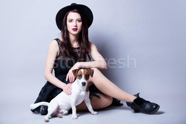 Gyönyörű fiatal nő kutya ül csodálatos fehér Stock fotó © Massonforstock