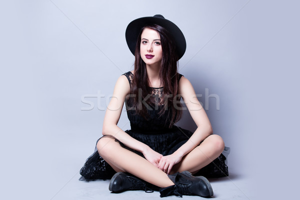 beautiful young woman sitting in front of wonderful white studio Stock photo © Massonforstock