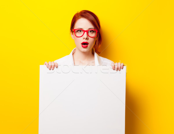photo of beautiful young woman holding empty poster on the wonde Stock photo © Massonforstock