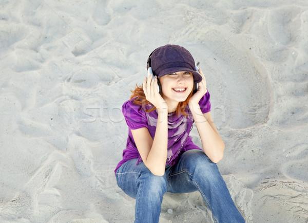 Retrato menina fone de ouvido praia mulher mar Foto stock © Massonforstock