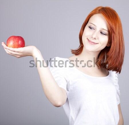 Nina manzana roja mano alimentos sonrisa mujeres Foto stock © Massonforstock