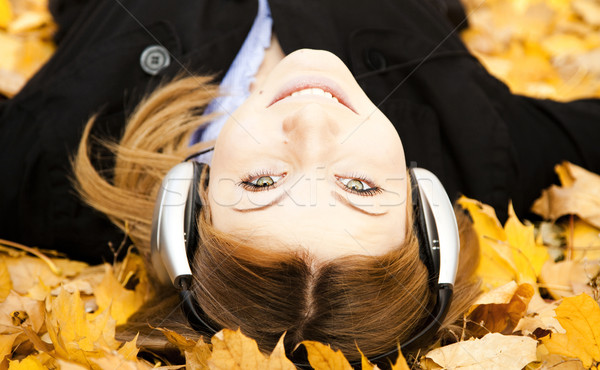 Portrait of a woman at outdoor with headphones Stock photo © Massonforstock