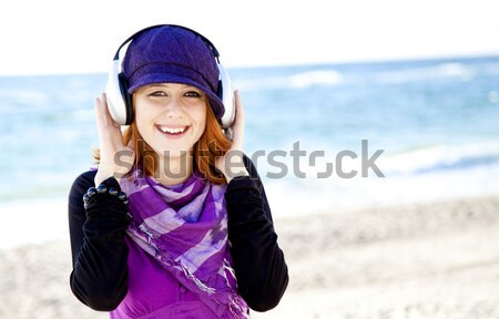 Retrato menina boné fone de ouvido praia mar Foto stock © Massonforstock