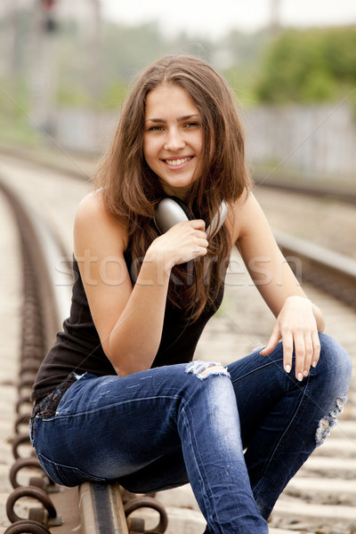 Teen girl with headphones at railways. Stock photo © Massonforstock