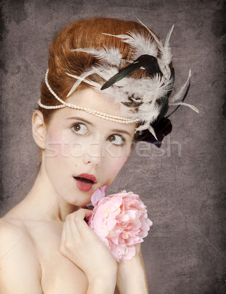 Surprised redhead girl with Rococo hair style and flower at vint Stock photo © Massonforstock