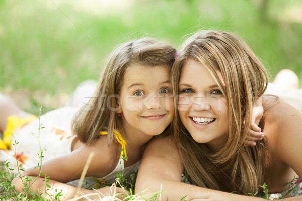 Two sisters in the park. Stock photo © Massonforstock
