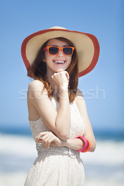 Redhead girl on the beack in spring time Stock photo © Massonforstock