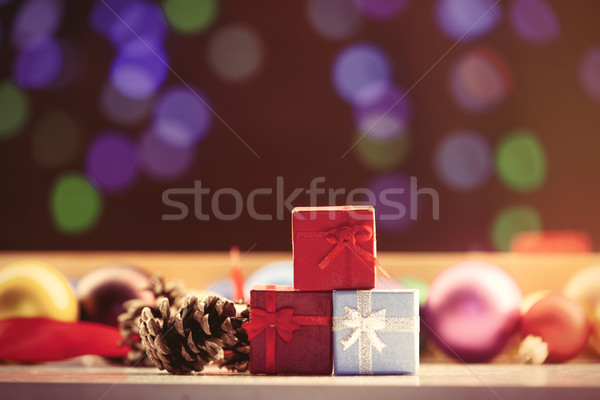 Christmas gifts and pine cone Stock photo © Massonforstock