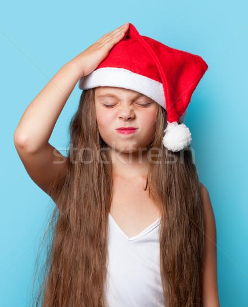 Young sad girl in Santas hat  Stock photo © Massonforstock