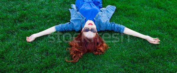 women lying down on green grass  Stock photo © Massonforstock