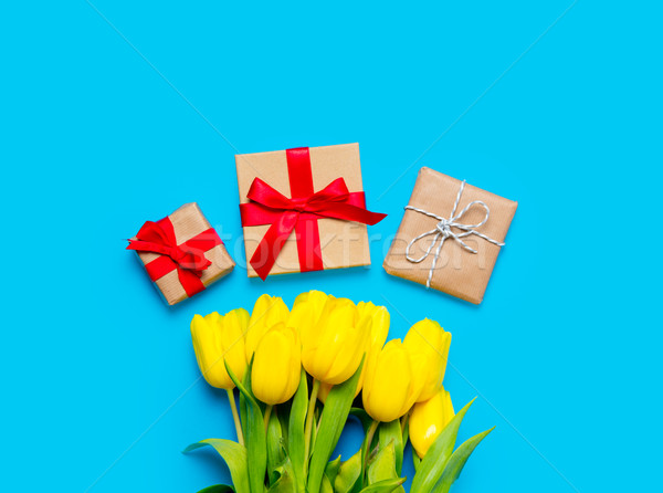 bunch of yellow tulips and beautiful gifts on the wonderful blue Stock photo © Massonforstock