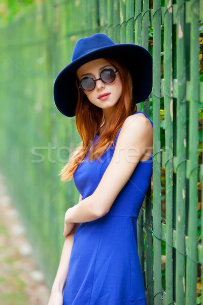 Stock photo: beautiful young woman walking in the park, versailles