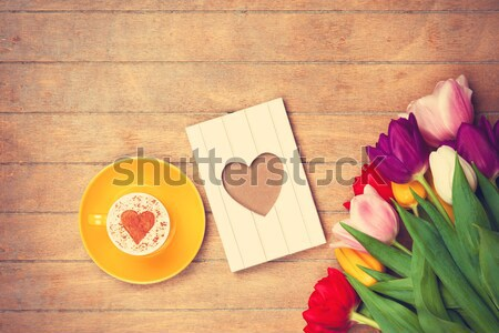 photo of beautiful bunch of colorful tulips, cup of coffee and p Stock photo © Massonforstock