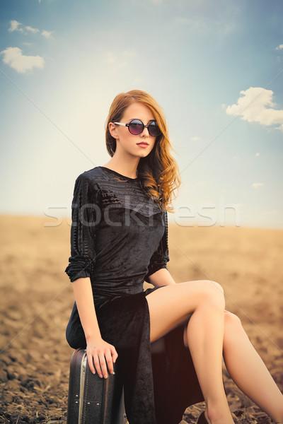 Photo belle jeune femme séance valise se demander Photo stock © Massonforstock