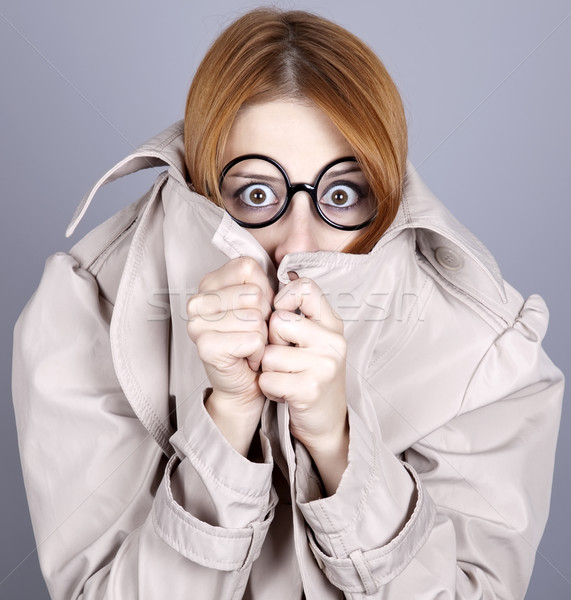 Hiding red-haired girl in glasses and cloak. Stock photo © Massonforstock