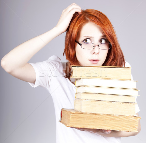 Red-haired businesswoman keep books in hand. Stock photo © Massonforstock