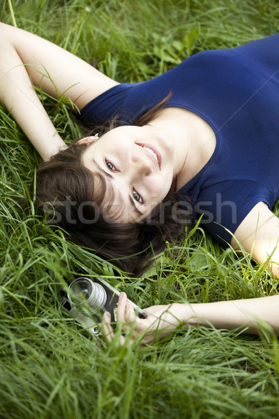 Teen girl with camera at the green park. Stock photo © Massonforstock