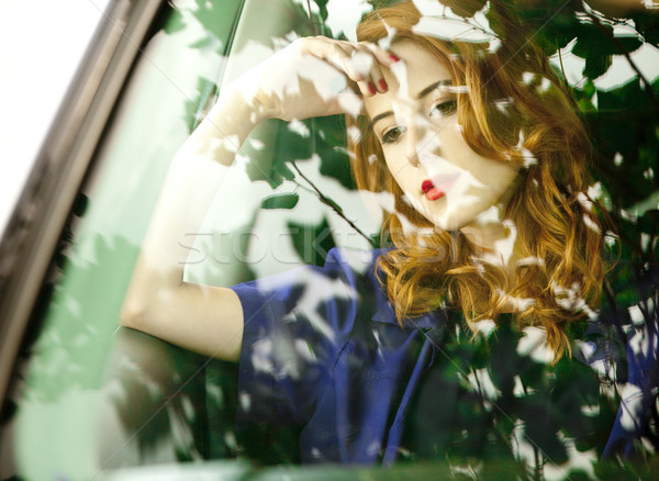 Beautiful redhead woman in the car. Stock photo © Massonforstock