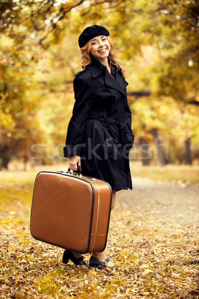 Style redhead girl with bag at the autumn park. Stock photo © Massonforstock