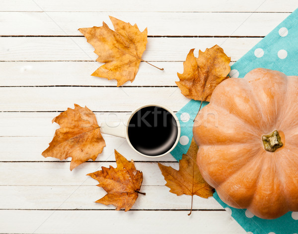 Cup of coffee and pumpkin with leafs Stock photo © Massonforstock