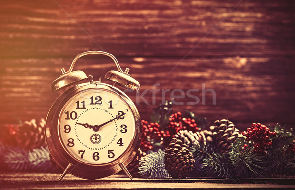 Alarm clock near Pine branches on wooden table. Stock photo © Massonforstock
