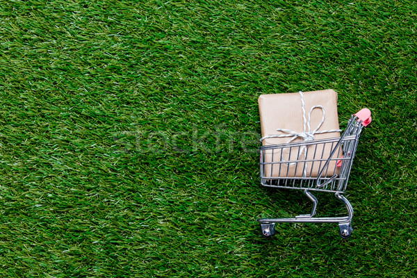 Self-service supermarket shopping trolley cart with gift box Stock photo © Massonforstock