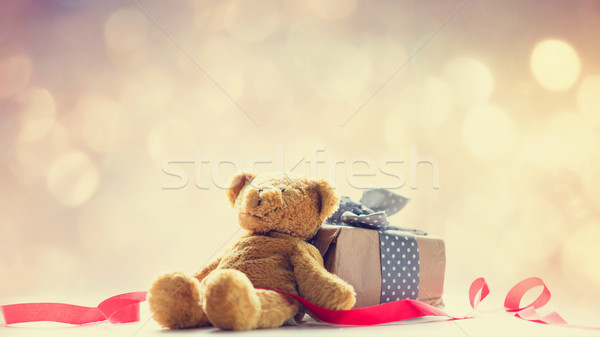 cute teddy bear, red ribbon and beautiful gift on the fairy ligh Stock photo © Massonforstock
