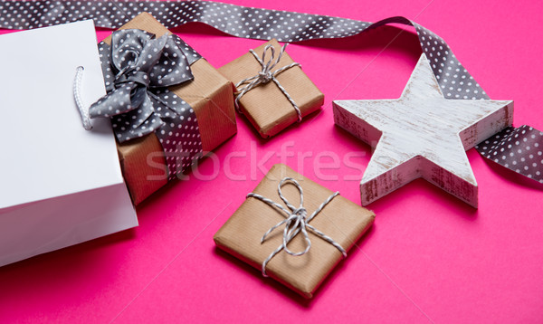 cute gifts, star shaped toy, shopping bag and black dotted ribbo Stock photo © Massonforstock
