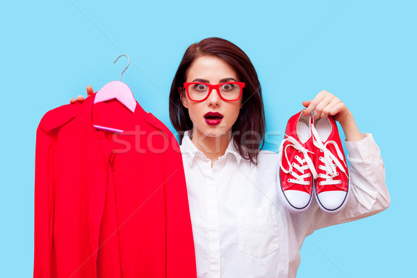beautiful young woman with shirt on hanger and gumshoes standing Stock photo © Massonforstock