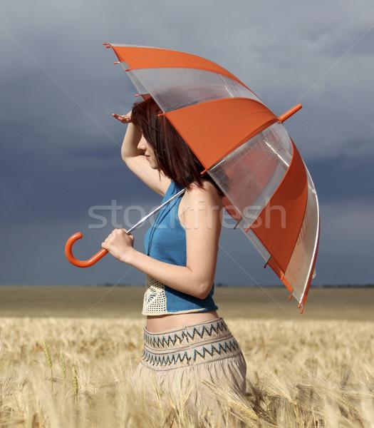 Сток-фото: девушки · Storm · день · зонтик · природы
