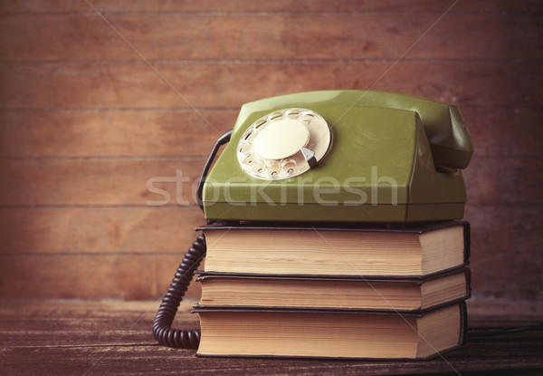 Dial phone over a books Stock photo © Massonforstock