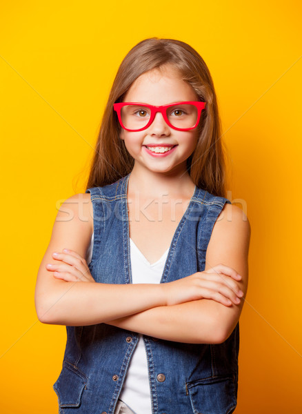Beautiful young girl with red glasses  Stock photo © Massonforstock