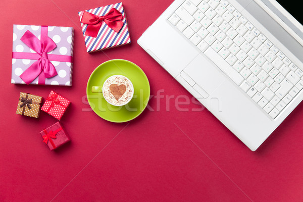 cup, gifts and laptop lying on the table Stock photo © Massonforstock