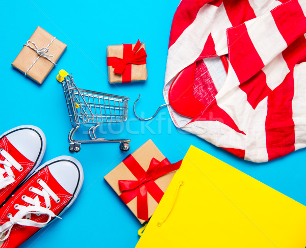big red gumshoes in cool shopping bag, shopping cart and beautif Stock photo © Massonforstock