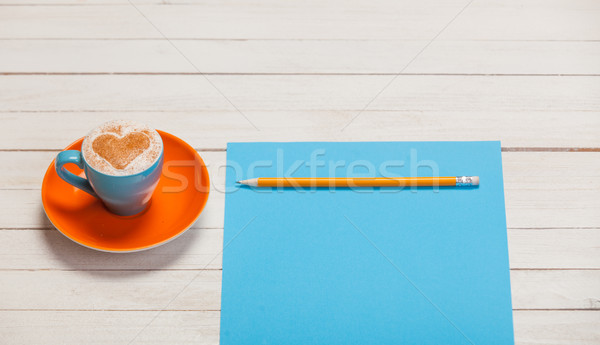 photo of beautiful blue cup of coffee and sheet of paper with pe Stock photo © Massonforstock
