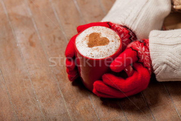 female hands in gloves holding cup of coffee on the wonderful br Stock photo © Massonforstock