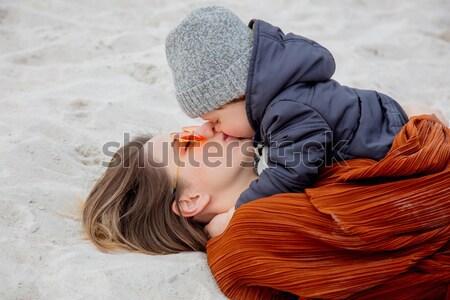 Beautiful brunet girl lie on the beach. Stock photo © Massonforstock