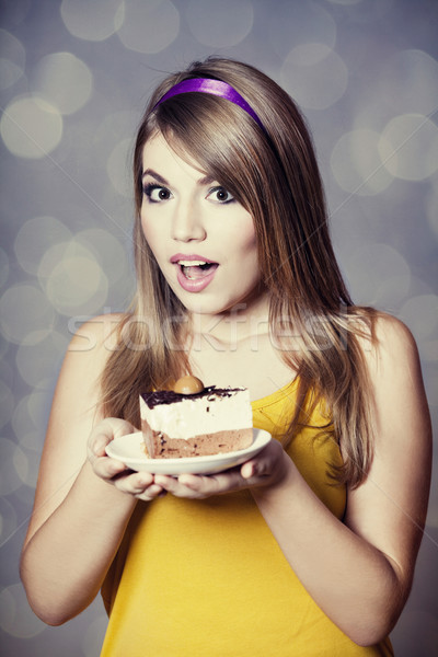 Style teen girl with cake. Photo with bokeh at background. Stock photo © Massonforstock