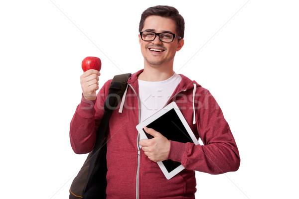 Fiatalember piros alma mosoly boldog diák háttér Stock fotó © Massonforstock