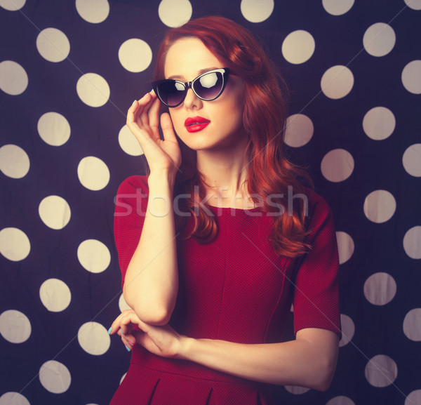 beautiful redhead girl in red dress  Stock photo © Massonforstock