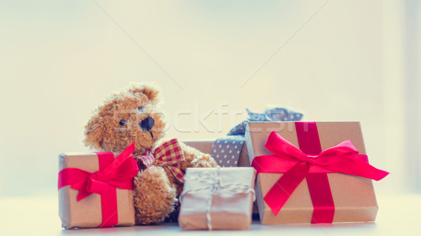 cute teddy bear and beautiful gifts on the wonderful white backg Stock photo © Massonforstock