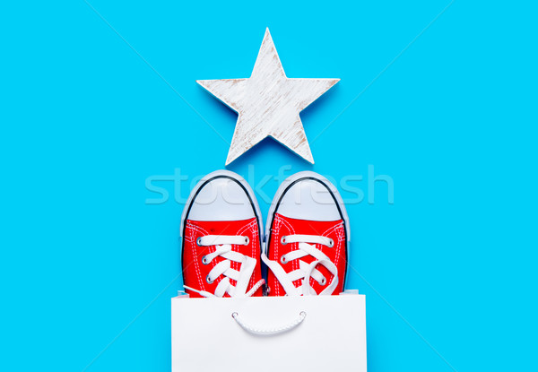 big red gumshoes in cool shopping bag and beautiful star shaped  Stock photo © Massonforstock