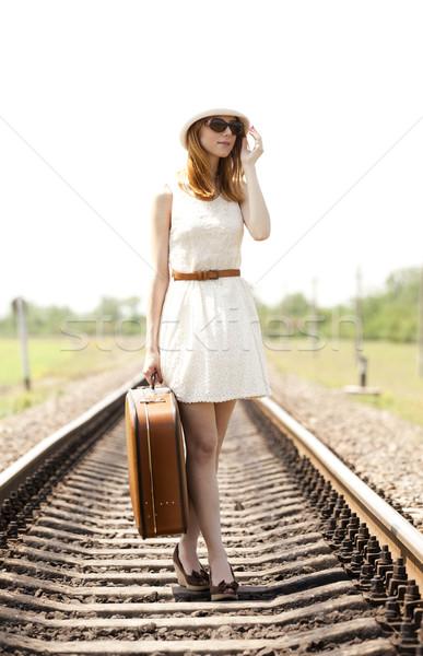 Fashion red-head girl at railways. Stock photo © Massonforstock