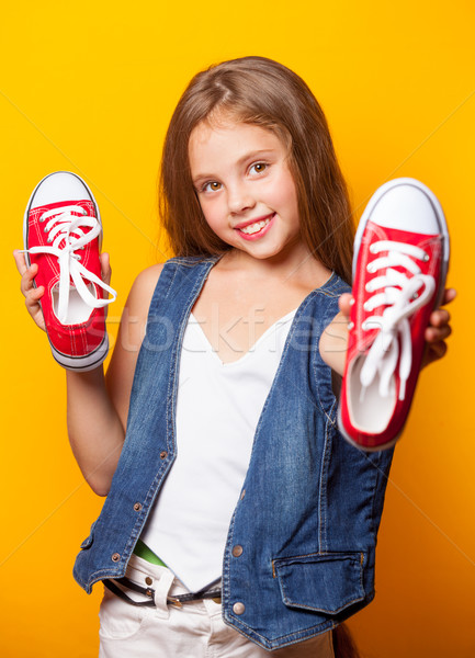 Young smiling girl with red gumshoes Stock photo © Massonforstock
