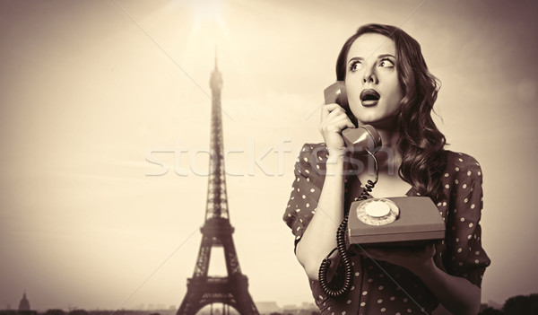 Menina discar telefone surpreendido Torre Eiffel cara Foto stock © Massonforstock