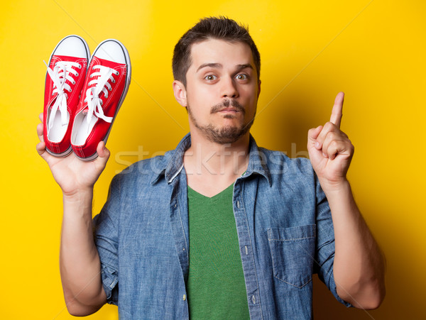 guy in shirt with red gumshoes Stock photo © Massonforstock